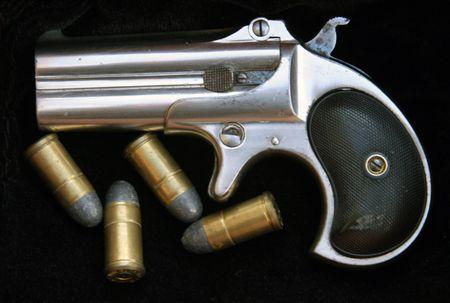 Circa 1889, Model 95, Type II Model 3 Double Derringer on black velvet with ammo Stock Photo - 295697