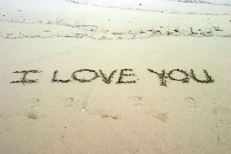 I Love You written in the sand on the beach