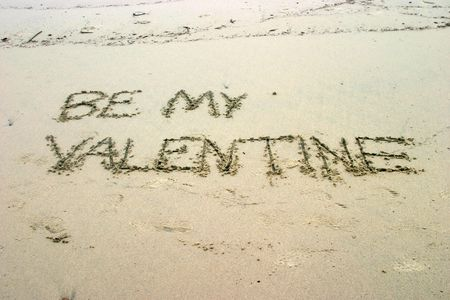Be my Valentine written in the sand on the beach photo