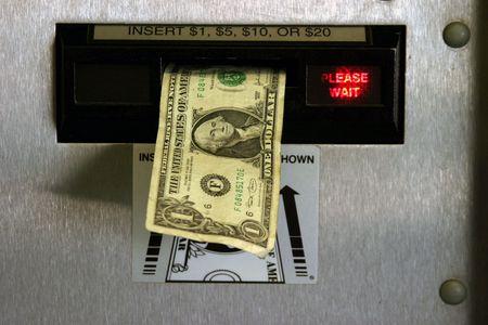 dollar bill in a change machine