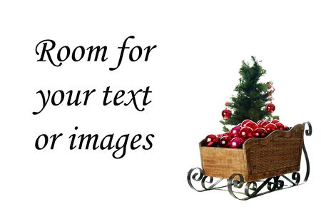 a santa sled filled with red christmas tree balls photo