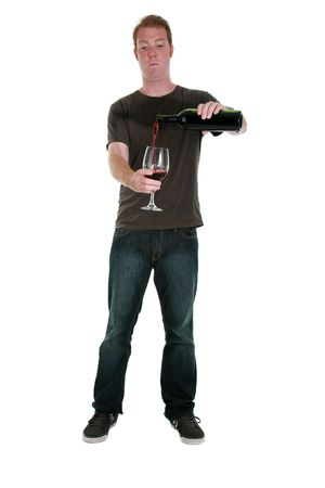 pours: a young man pours a glass of red wine, isolated on white  Stock Photo
