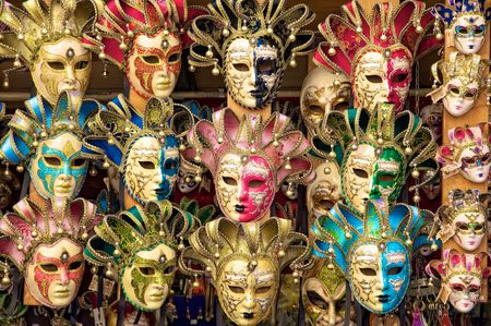 carnival festival: Italian carnival masks for sale from a vendors cart in Florence (Firenze), Italy.
