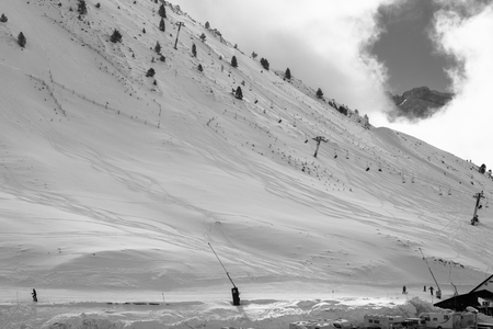 Snow, sky traces, empty slopes and clouds