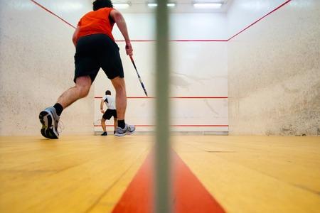 Two friends having good sport time playing squash in Mutilva, Navarra, Spain Archivio Fotografico