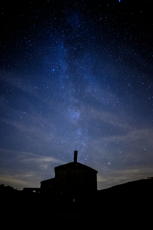 Milky way comming from Eunate church in a cloudy night near Pamplona, Spain 写真素材