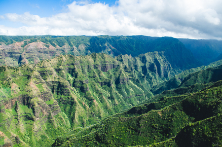 Aerial voew of the typical abrupt mountain ranges in Kauai, US