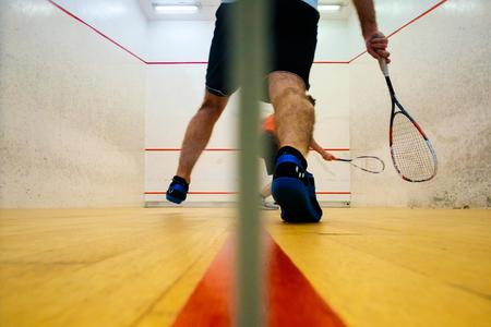 Two friends playing squash in Mutilva, Navarra, Spain Stock Photo