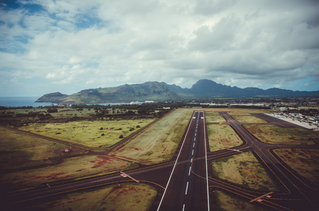 Landing road pointing to one of the peaks of Kauai, US
