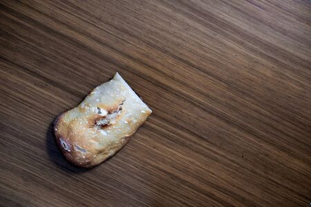 A piece of home made bread over the kitchen table
