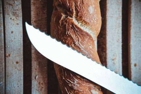 Artisanal bread stick on wood table