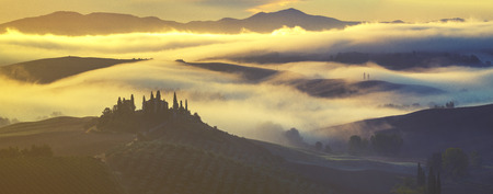 Misty, sunny morning in Tuscany, Val dOrcia Italy Stock Photo