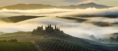 wine road: Pienza,Italy-September 2015:the famous Tuscan landscape at sunrise