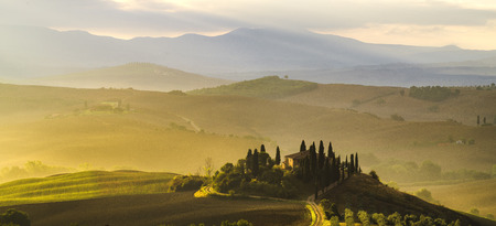 cappella: Pienza,Italy-September 2015:the famous Tuscan landscape at sunrise