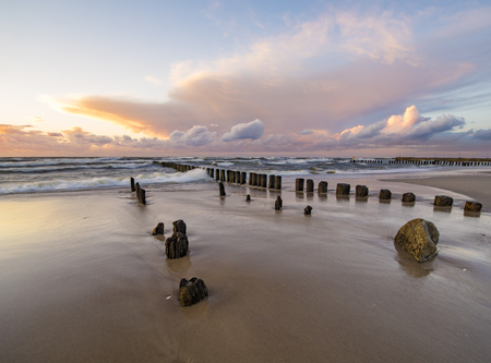 breakwaters: beach and offshore breakwaters during a beautiful sunset, baltic sea