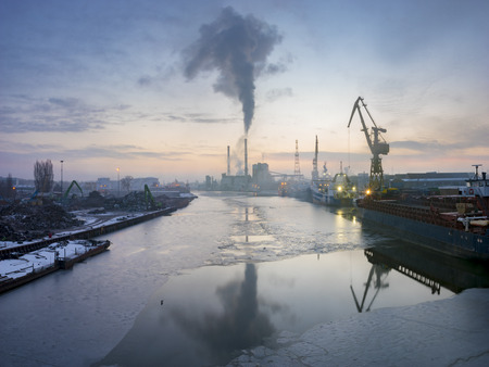 particulate: industrial areas on the Oder River in Szczecin shipyard, power plant, scrap yard Stock Photo