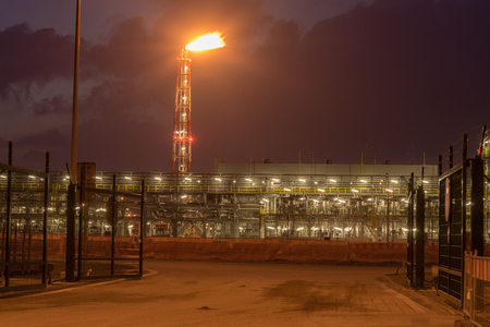 LNG terminal at night Stock Photo