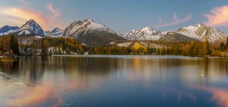 Winter morning over a mountain lake in Slovakia, High Tatras, Strbske Pleso