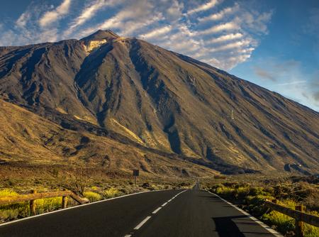 asphalt road running at the foot of the volcano