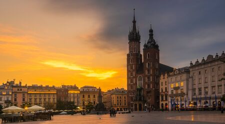 Krakow, Poland-June 2018:St. Mary's Church on the old market square in Krakow at sunrise