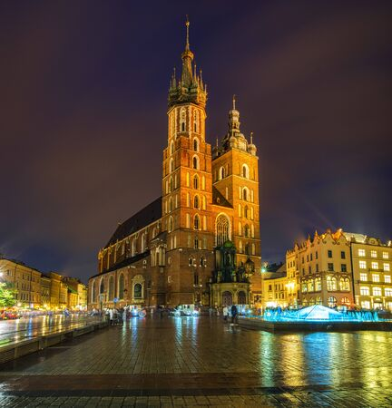 Krakow, Poland-June 2018:St. Mary's Church on the old market square in Krakow Editorial