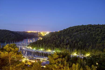 Skradin, a charming port town on the Krka River near the Krka Park. Standard-Bild - 131947710