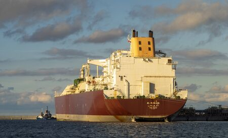 Swinoujscie, Poland-October 2019: AL RUWAIS, LNG Tanker, sailing under the flag of [BS] Bahamas, during the delivery of liquefied gas to the LNG terminal in Swinoujscie Standard-Bild - 132235304