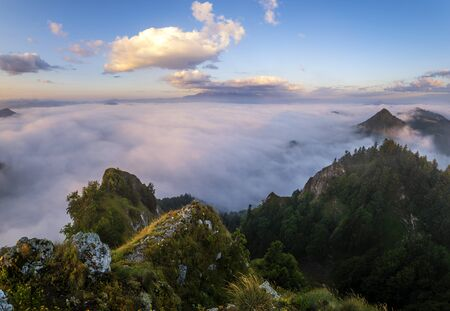 panorama of mountains and valleys covered with morning fog in the beautiful , spectacular sunrise from the top-Pieniny mountains, Three Crowns, Poland 写真素材