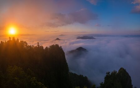 beautiful, spectacular sunrise above the clouds at the top of Three Crowns-Pieniny, Poland 写真素材