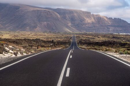 Tourist, scenic road to Lanzarote, running near the ocean