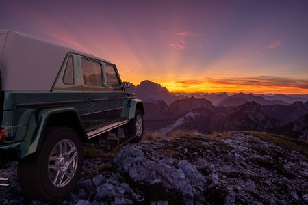 Mercedes-Maybach G 650 Landaulet on the top of the mountain Standard-Bild - 141810668