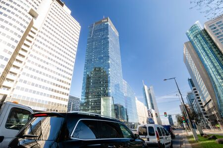 The modern center of Warsaw, the Q 22 skyscraper in the foreground Standard-Bild - 141810669