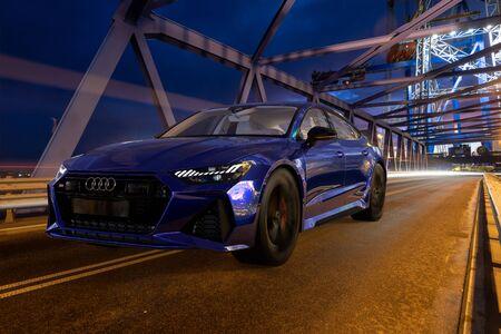 Audi RS 7 driving by illuminated bridge at night Standard-Bild - 141810684
