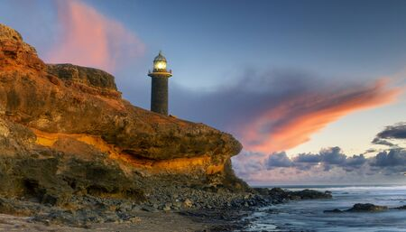 Beautiful sunset on the cliffs of Faro de Jandia in Fuerteventura