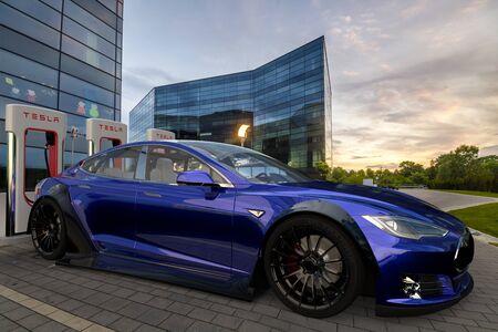 Electric Tesla Model S while charging Standard-Bild - 141810687