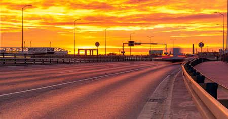 highway that runs through the city during a spectacular sunrise Standard-Bild - 159814292