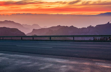 asphalt road in the mountains at sunset Standard-Bild - 159781776