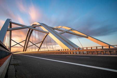 Modern construction highway bridge at sunset