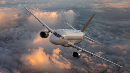 Passenger plane rising above the clouds Banco de Imagens