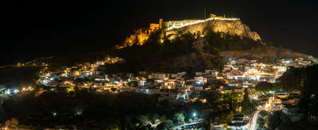 panoramic view of Lindos, town, fortress and Acropolis. Night photography. Rhodes, Greece Standard-Bild