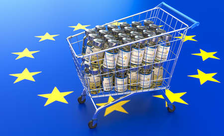 A small shopping basket filled with coronavirus vaccines against the background of the European Union flag