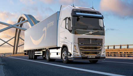 Volvo truck with a trailer bearing the Amazon Prime