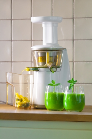 slow juicer with wheat grass juice