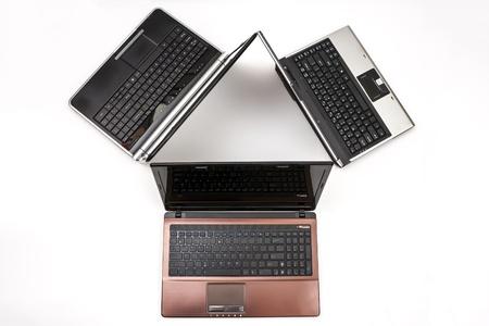 three laptops isolated on white photo