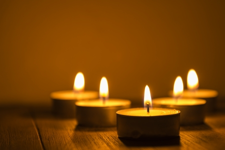 five tea lights on a table, shallow depth of field  Stock Photo