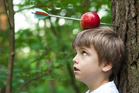 trust people: kid with apple on his head Stock Photo