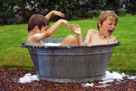 kids in bathtub Stock Photo