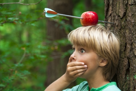 kid with apple on his head and arrow shot through