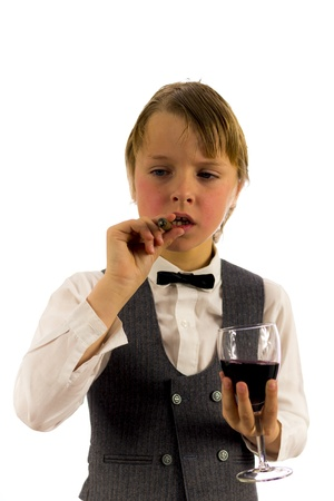 boy in tuxedo, with glass of red wine and a cigar Stock Photo - 18767198