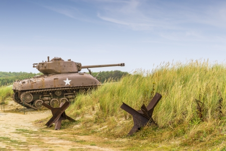 tank: a ww2 sherman tank on utah beach normandy  Stock Photo